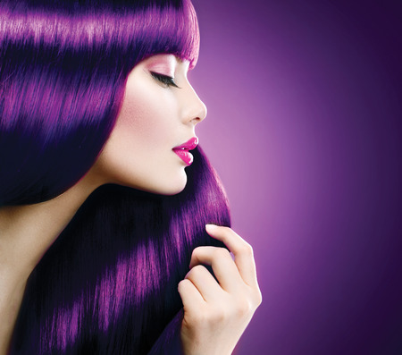 colours: Beauty woman with perfect makeup and coloring violet hair