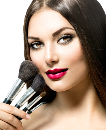 beauty: Beauty Woman with Makeup Brushes. Applying Holiday Makeup Stock Photo