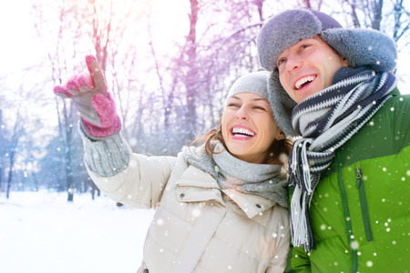 snow woman: Winter Vacation. Happy Couple Having Fun Outdoors