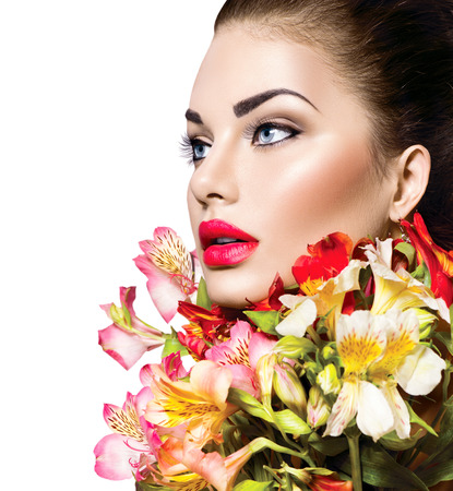High fashion model girl with colorful flowers and red lips photo