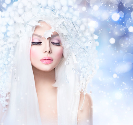 Winter Beauty. Fashion Model Girl with Snow Hairstyle and Makeup photo