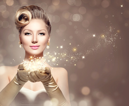 lady: Holiday retro woman with magic stars in her hands Stock Photo