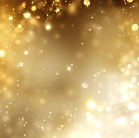 ster: Kerstmis gouden achtergrond. Gouden gloeiende achtergrond