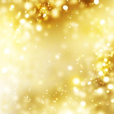 金: クリスマス金背景。ゴールデン休日熱烈な背景