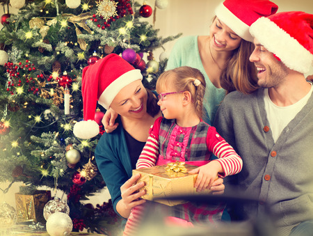 Happy Smiling Family at Home Celebrating Christmas photo