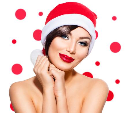 feriado: Mujer de la Navidad. Belleza Modelo Chica en el sombrero de Santa sobre blanco