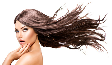 nude model: Fashion Model Girl Portrait with Long Blowing Hair Stock Photo