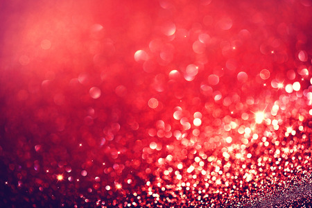 bokeh: Christmas Background. Red Holiday Blinking Background Stock Photo