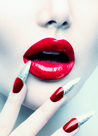 beautiful vampire: Makeup and Manicure. Red Long Nails and Red Glossy Lips Stock Photo
