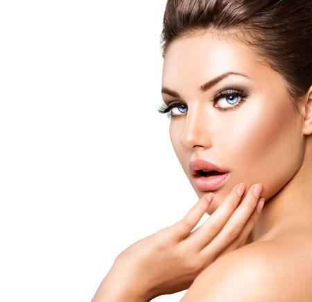 Beautiful young woman portrait. Spa woman touching her skin photo