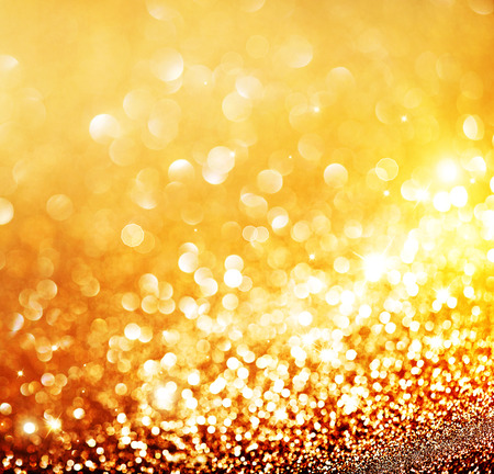 sparkles: Christmas gold background. Golden holiday glowing background
