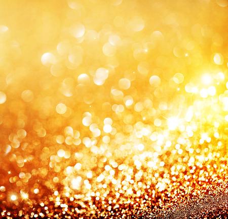 weihnachten gold: Weihnachtsgoldhintergrund. Golden leuchtenden Hintergrund