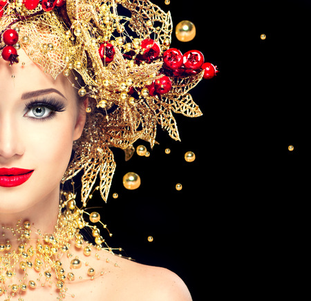 christmas gold: Christmas winter fashion model girl with golden hairstyle