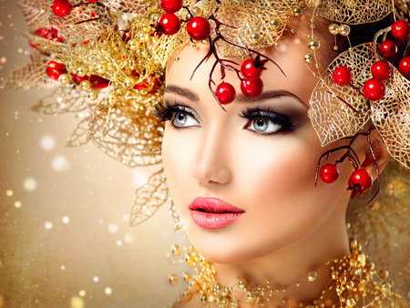 facial: Christmas fashion model girl with golden hairstyle and makeup