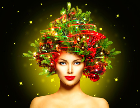 gold facial: Winter Fashion Model Girl with Christmas tree hairstyle