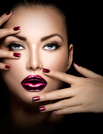 red nail colour: Fashion model girl face, beauty woman makeup and manicure