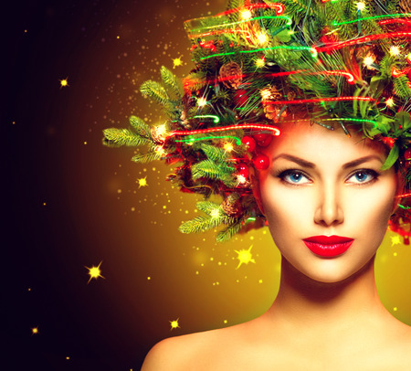 golden light: Christmas Winter Woman. Beautiful Christmas Holiday Hairstyle Stock Photo