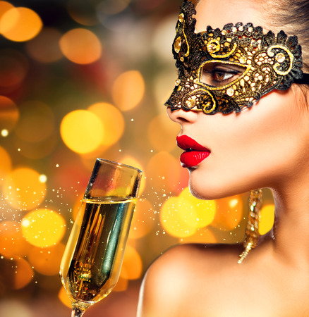 masks: Sexy model woman with glass of champagne wearing mask
