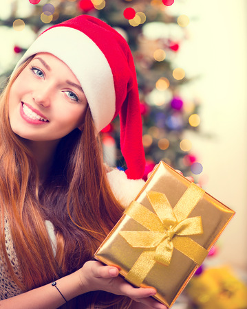 Happy Young Woman With Christmas Gift Box photo