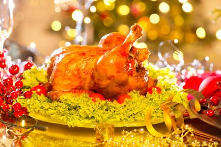 oven chicken: Christmas table setting with turkey. Holiday Christmas dinner Stock Photo