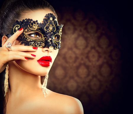 Beauty model woman wearing masquerade carnival mask photo