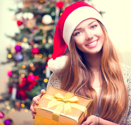 x mass: Happy Young Woman With Christmas Gift Box Stock Photo