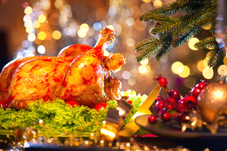 Christmas dinner. Holiday decorated table with roasted turkey Stock Photo