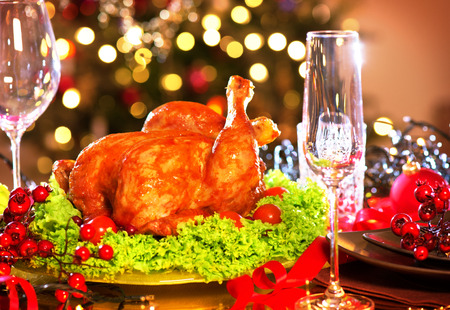 light meal: Christmas dinner. Holiday decorated table with roasted turkey Stock Photo
