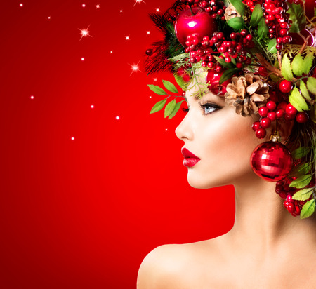 year profile: Christmas Winter Woman. Beautiful Christmas Holiday Hairstyle Stock Photo