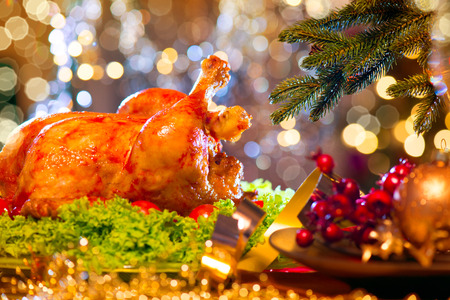 Christmas dinner. Holiday decorated table with roasted turkey Archivio Fotografico