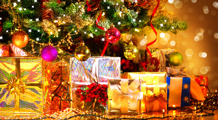 gift background: Holiday Christmas scene. Gifts under the Christmas tree