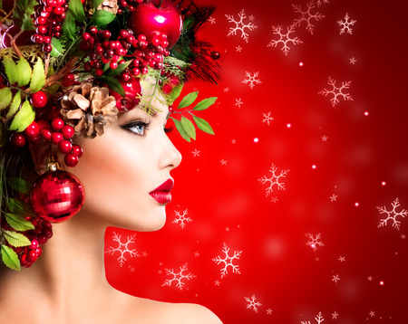 Christmas Winter Woman. Beautiful Christmas Holiday Hairstyle Stock Photo