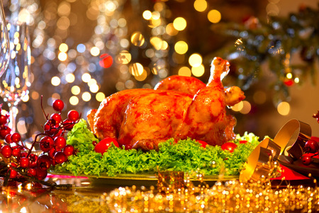 roasted turkey: Christmas dinner. Holiday decorated table with roasted turkey Stock Photo