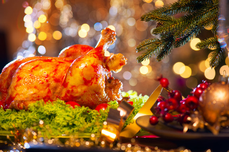 chicken salad: Christmas dinner. Holiday decorated table with roasted turkey Stock Photo