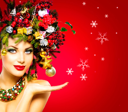 make a gift: Christmas Winter Woman. Beautiful Christmas Holiday Hairstyle Stock Photo