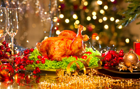 plate of food: Christmas dinner. Holiday decorated table with roasted turkey Stock Photo