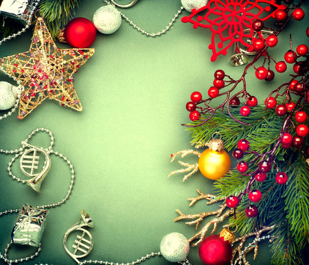 Christmas vintage green background with retro styled baubles photo