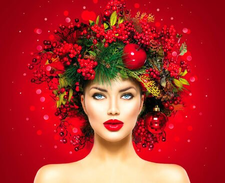 face: Christmas fashion model woman. New Year hairstyle and makeup Stock Photo