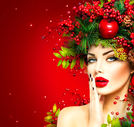 Kerst fashion model vrouw. Xmas kapsel en make-up Stockfoto