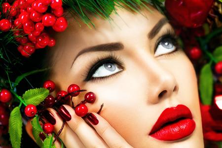 Christmas Winter Woman. Beautiful Christmas Holiday Hairstyle photo