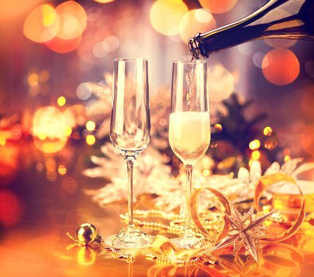 settings: Christmas holiday decorated table. Champagne glasses Stock Photo