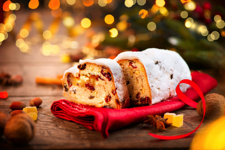 Christmas Stollen. Traditional Sweet Fruit Loaf with Icing Sugar Stock Photo