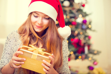 Happy Surprised Girl With Christmas Gift Box photo