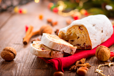 Christmas Stollen. Traditional Sweet Fruit Loaf with Icing Sugar photo