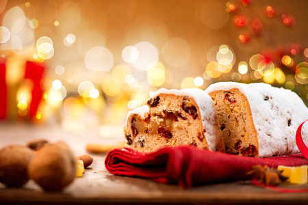 scene season: Christmas Stollen. Traditional Sweet Fruit Loaf with Icing Sugar Stock Photo
