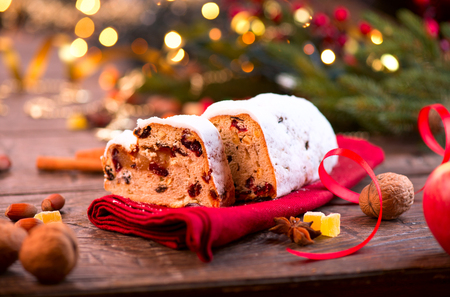 stollen: Christmas Stollen. Traditional Sweet Fruit Loaf with Icing Sugar Stock Photo