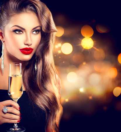 long hair model: Sexy girl with glass of champagne over holiday background Stock Photo