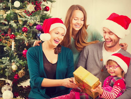 Christmas family with kids opening christmas gifts photo