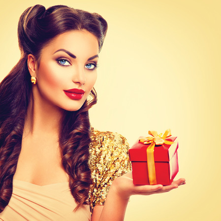 Beauty pin up girl with holiday gift box in her hand Stock Photo