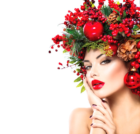 balls decorated: Christmas fashion model woman. New Year hairstyle and makeup Stock Photo